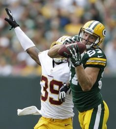 Green Bay Packers' Jordy Nelson pulls down a first down reception against Washington Redskins' David Amerson in the third quarter. The Green Bay Packers host the Washington Redskins Sunday, September 15, 2013, at Lambeau Field in Green Bay, Wisconsin. Dan Powers/Post-Crescent Media