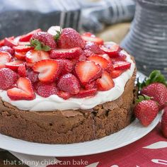 Chocolate Souffle Cake | Watch this cake rise and fall leaving a perfect well for sweet cream and berries