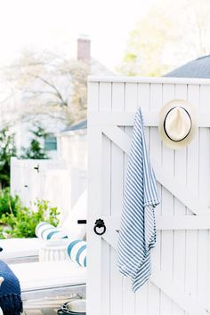 Pool party decor ideas. Hooks for hanging towels and hats outdoors.