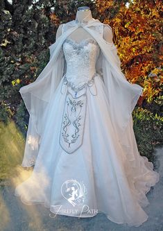 """Hyrule Gown by FireflyPath """" This gown is ideal for the bride who desires a timeless fantasy wedding! The gown is crafted in warm white tone fabrics. Peekaboo sleeves with long bell-shaped chiffon. Pretty Dresses, Beautiful Dresses, Awesome Dresses, Fantasy Gowns, Fantasy Wedding Dresses, Fantasy Outfits, Elven Wedding Dress, Elvish Wedding, Wedding Vows"""