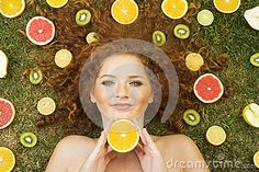 Photo about Girl with fruit lying on the grass. Image of hair, kiwi, fresh - 26691489 Kiwi, Grass, Royalty, Fruit, Artwork, Hair, Image, Royals, Work Of Art