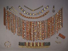 Queen Pu-abi's beaded cape, belt, and jewelry. The circle on the lower left is her garter; on the lower right is her wrist cuff (bracelet). According to Wolley's publication, Puabi's bones were totally covered up with lapis lazuli, carnelian and. Ancient Jewelry, Antique Jewelry, Ethnic Jewelry, Gold Jewelry, Beaded Cape, Gold Finger Rings, Ancient Mesopotamia, Ancient Egypt, Ancient Aliens