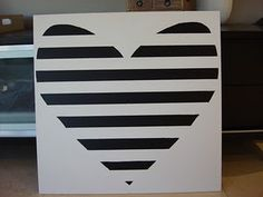 diy black and white heart painting.  Could do this with a white canvas and washi tape!