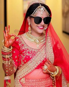 The bride with swag level {Click by Fantastic Foto} Indian Bridal Photos, Indian Wedding Poses, Indian Wedding Couple Photography, Bride Photography, Couple Wedding Dress, Wedding Couple Photos, Photo Poses For Couples, Bridal Photoshoot, Best Wedding Photographers