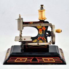 This is a darling vintage sewing machine from the renowned German toy company, Casige.This is the most wonderful tin metal sewing machine with great
