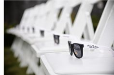 Cute idea for an outside wedding :) I like how they are already set out on the chairs.
