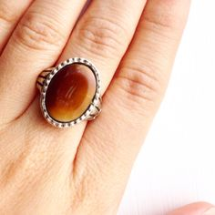 Brown Glass Adjustable Ring  by lydiasvintage on Etsy https://www.etsy.com/listing/200588161/brown-glass-adjustable-ring
