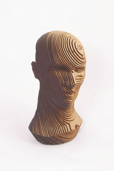 3D Printed Art. 3D model  Sliced 3D model of a head made from 2 mm MDF. Made using Autodesk 123D make.