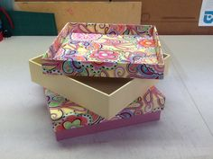 Boxes I make with quilting fabric. I also give classes on how to cover a box