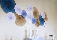 Wall fans are made with wrapping paper and scrapbook paper