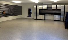 Epoxy coated garage floor coating with a polyaspartic top coat by The Garage…