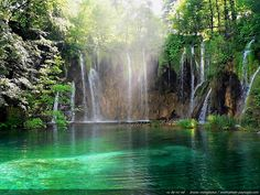 This is paradise on Earth : green lake, sunrays and waterfalls in the forest...Plitvice lakes and waterfalls. Croatia