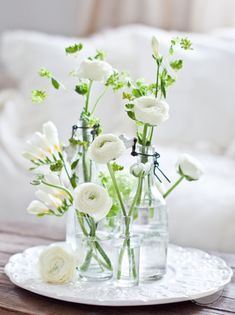 White Ranunculous in clean glasses and vintage vase - so pretty and spring like!