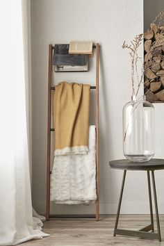 Think beyond typical towel bars and bring a unique twist into your bathroom with this wood and metal ladder. Perfect for hanging your bath sheets and hand towels in style, this sturdy industrial-inspired black and natural piece will enhance your decor's modern feel. It would also make a great addition to your bedroom as a place to display light blankets or pretty scarves. Lean one up against your wall and get creative! Towel Bars, Bath Sheets, Fall Collections, Wood And Metal, Hand Towels, Modern Decor, Ladder Decor, Blankets, Scarves