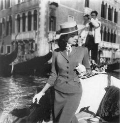 Ivy Nicholson in a gondola, wearing a suit by Charles Montaigne. Venice, Italy. Photo by Henry Clarke 1956.