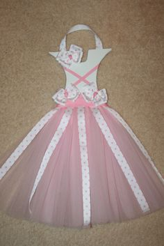 Hair bows & Holder.  This would be adorable to do it in Disney Princess Colors.