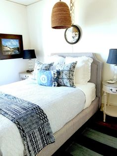 The beautiful guest room is layered with blue and white linens on a bed with ticking stripe. Rattan, Wicker, Old Apartments, White Houses, House Tours, Blue And White, Beautiful, Classic, Furniture