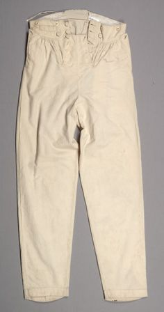"Wedding suit white trousers Date: ca. 1824 Media: Wool Accession Number: 37197.2 Drop front cream wool flannel trousers. Hand-written on pocket, :Trenor"", Button-front waistband and drop front. Side pockets and fob pocket on waist. Buttons for suspenders."