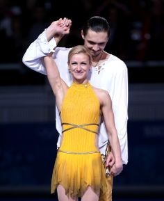 Gold medalists Tatiana Volosozhar and Maxim Trankov of Russia celebrate on the podium during the flower ceremony for the Figure Skating Pair...