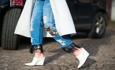 Add some fringe to the hem and you'll be looking for excuses to walk around. | 30 Hella Easy Ways To Seriously Transform Your Old Jeans