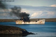 RFA (Royal Fleet Auxiliary) Sir Galahad still burning after being struck by three tail bombs and set alight on the 8th June 1982 during the Falklands war. 69 crew were lost.