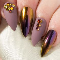 This smouldering chrome nail design is sure to put a swagger in your step, and a sinful smile on your lips. Featuring a decadent purple and copper ombré and an elegant mauve matte embellished with glittering Swarovski® crystals, these false nails are just waiting to wrap you in glamour. Coated with two layers of gel top coat for extra durability and a soft-touch matte finish, they are provided with all the accessories youll need for a flawless application. They also come in a choice of nine