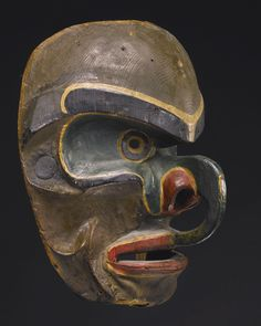 Kwakiutl Polychrome Wood Mask Depicting Bakwas, British Columbia, Canada -   wood, cotton canvas, iron nails, mineral and commercial pigments.  11 in. length by 5 in. width by 6 in. depth