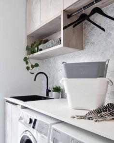 This white sleek countertop is juxtaposed by timber cabinetry and a vintage-inspired goose-neck tap; seeing the old collide with the new. Ikea Laundry, Laundry Decor, Laundry Room Organization, Laundry In Bathroom, Modern Laundry Rooms, Mug Design, Laundry Room Inspiration, Ikea Bathroom, Small Room Bedroom