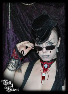 """Blood Elixir choker. Vampire skeleton cameo with a vial with the label """"Wine"""", which contains blood red gel, scented with a lovely perfume oil.   ( - No need to wear perfume with this piece! Great for perfume allergies!) £29"""