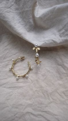 Dainty gold plated hoop with pearl and gold leaf details Gold Leaf, Hoop Earrings, Brooch, Pearls, Detail, Bracelets, Jewelry, Jewlery, Jewerly