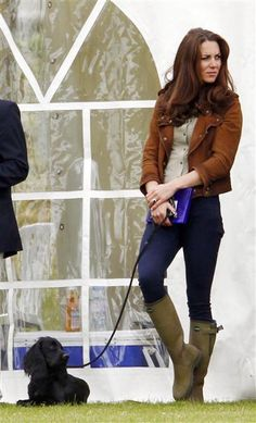 Catherine Duchess of Cambridge and her dog Lupo hang out at the Exhibition Polo Match At The Beaufort Polo Club on June 17, 2012.