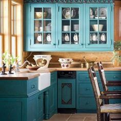 L Shape Teal Kitchen Cabinets Feat Brown Countertop In Orange Wall Also Some Brown Wood Chairs On Tile Floor White Snk Glass Window At Interesting Cabinet
