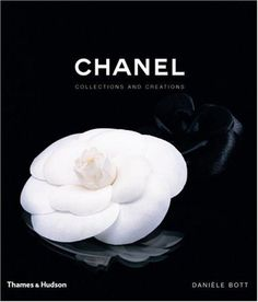 Cameilla flower :) This book describes the fashion design of Coco Chanel, accompanied by photographs of Chanel collection pieces. The book is grouped into sections: the suit, the camellia (Chanel's signature symbol), jewelry, makeup and perfume, and the little black dress.
