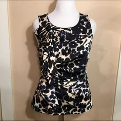 NWOT Ann Taylor floral top Gorgeous floral top from Ann Taylor. The top has a little stretch and has a vertical ruffle on the left side. Ann Taylor Tops