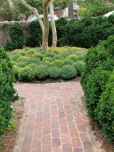 Brick pathway to a fall planting at Colonial Williamsburg.