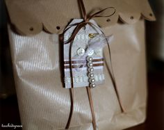 tag with pearls, buttons and ribbons