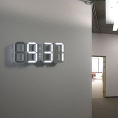 Digital wall/desk white LED clock with white frame digits. Nothing else, simply time. White & White Clock is a clock with an alarm and time display mode 24 hour. In dark hours the light sensitive sensor changes the brightness of the digits to a less intense white. The power supply is conducted through a general mains-operated adapter that suits any kinds of sockets.