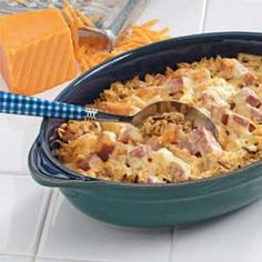 Chicken Ham casserole  1 package (6 ounces) long grain and wild rice mix  2 cups cubed cooked chicken  1 cup cubed fully cooked ham  1 can (10-3/4 ounces) condensed cream of chicken soup, undiluted  1 can (12 ounces) evaporated milk  1 cup (4 ounces) shredded Colby cheese  1/8 teaspoon pepper  1/4 cup grated Parmesan cheese