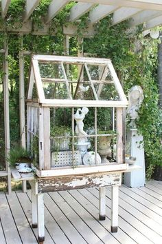 little green house made from repurposed windows ..