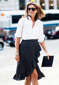Sometimes simpler is better. Natalie Massenet, the founder of Net-a-Porter looks phenomenal in this over-sized white button down and black skirt.