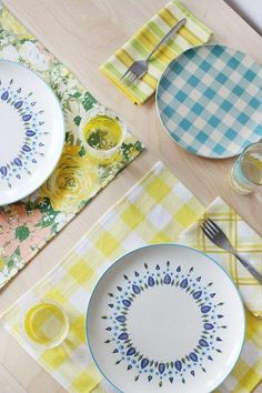 So many smart #DIYs for old bed sheets in this roundup — we especially love these mismatched plaids-and-florals table linens.