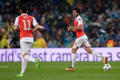 Arsenal's Egyptian midfielder Mohamed Elneny celebrates his goal during the UEFA Champions League Round of 16 second leg football match FC Barcelona vs Arsenal FC at the Camp Nou stadium in Barcelona on March 16, 2016.