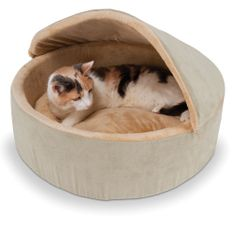 The Warming Cat Bed (Small) - Hammacher Schlemmer.  Great for older or arthritic pets