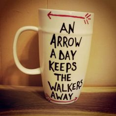 An arrow a day keeps the walkers away./hand painted/mug/cup/coffee/The Walking Dead/Daryl Dixon from LOVEinamug on Etsy. Saved to LOVEinamug my. Walking Dead Gifts, Fear The Walking Dead, Walking Dead Stuff, Funny Coffee Cups, Funny Mugs, Coffee Mugs, Hand Painted Mugs, Stuff And Thangs, Daryl Dixon
