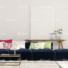 Blue sofa and a wooden console with a canvas – banque photo libre de droits