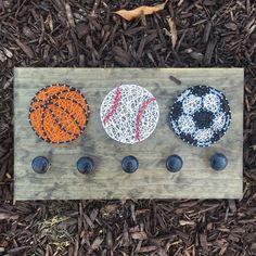 Sports String Art Hooks, Sports Coat Hanger, String Art, Custom String Art, Basketball, Baseball, Soccer, Softball, Kids Room by TiedByTwins on Etsy https://www.etsy.com/listing/270218372/sports-string-art-hooks-sports-coat