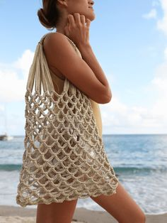 This hand-braided open weave market tote bag comes with a removable, waterproof clear plastic insert making it practical for everyday, but also ideal for a lightweight elegant beachside getaway. Crochet Beach Bags, Crochet Market Bag, Crochet Bags, Macrame Purse, Crochet Handbags, Beach Tote Bags, Cloth Bags, Bikini, Crochet Designs