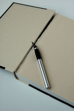 Using an old book as a cover to make a binder. AMAZING idea!!