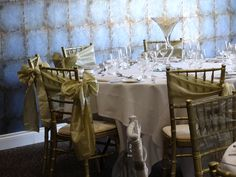 Wedding breakfast set up with gold taffeta sashes.  Want your own quote? Then email me with your ideas! hello@beckiemelvinevents.co.uk  More styles can be seen at www.beckiemelvinevents.co.uk