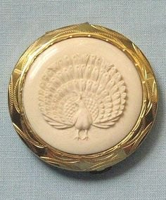 Vintage Compact with carved peacock motif on lid